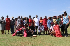 Visitors interacting with Maasai and learning their culture